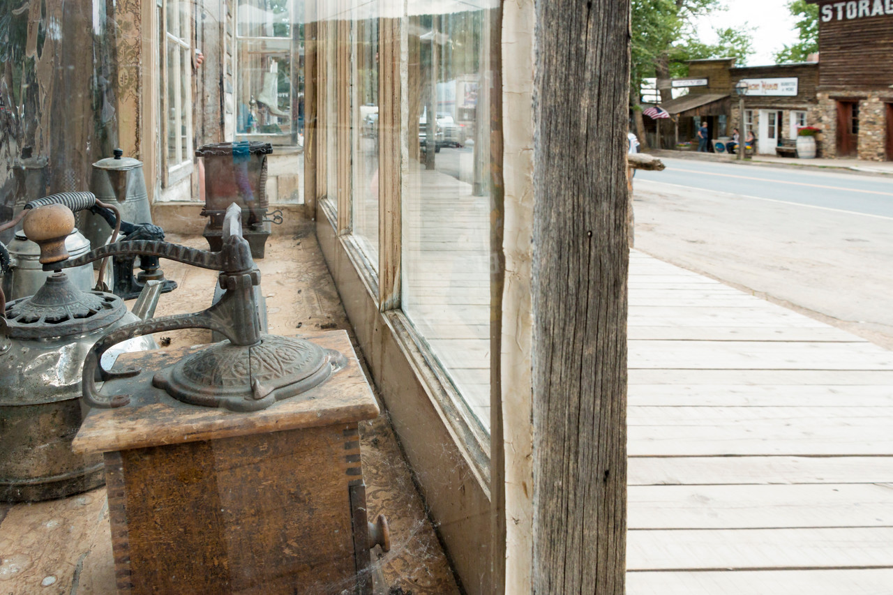 Coffee grinder in store window (empty boardwalk)