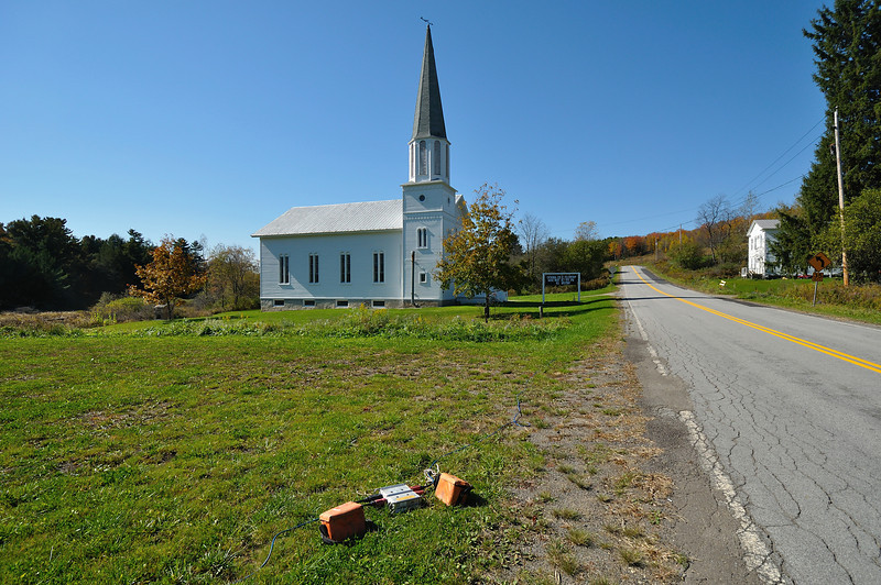 Chenunda Creek church at Independence.  A seismic cable for gas drilling runs along the road.  Nikon D5000 (October 2010).