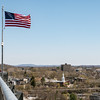 Flag on walkway with Poughkeepsie in background