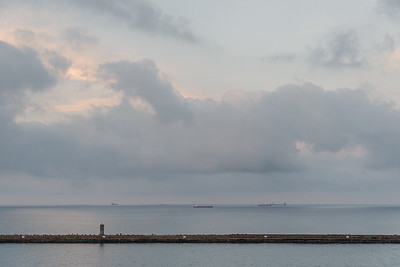 Ships at anchor in morning twilight - Livorno, Italy - August 16, 2020