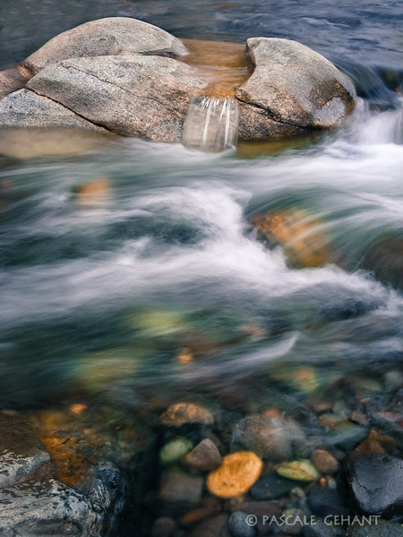 Rushing water over pebbles