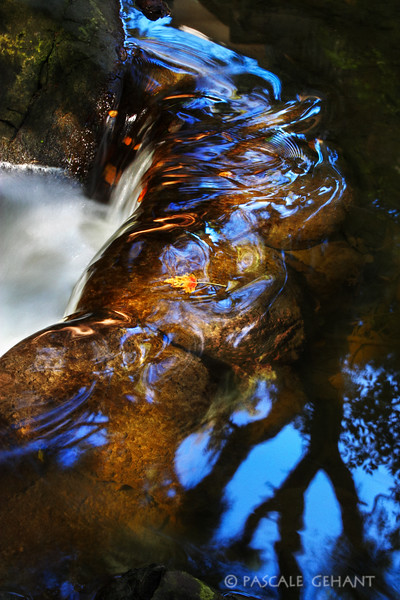 Glossy waterfall with reflections