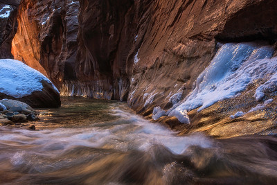 Chasing light in the ice and snow filled Narrows. Zion National Park, Utah