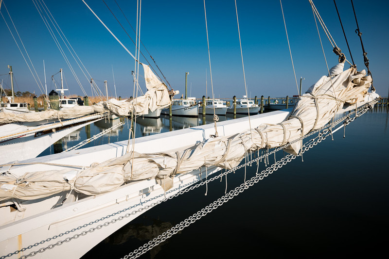 Furled Skipjack Sails and Deadrise Crab Boats