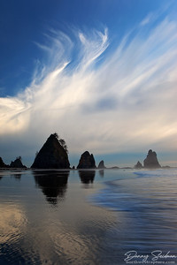 A beautiful display of late-afternoon cirrus clouds perfectly complement the sea stacks on Shi Shi Beach.