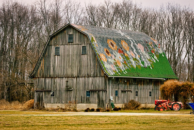 Weathered Barn with Patchwork Roof