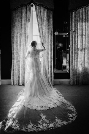 Bride at the window in black-and-white