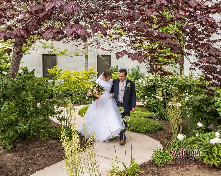 bride and groom walking at Salt Lake Temple