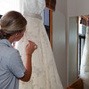Last minute adjustments to the dress.