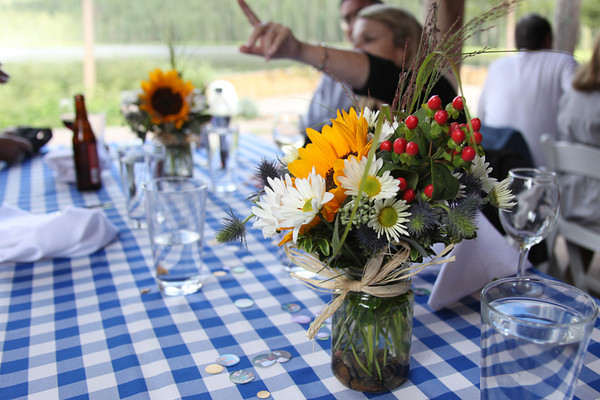 The rustic center pieces were perfect for the setting.