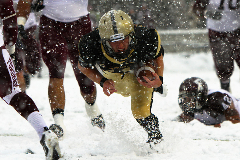 Army Quarterback Max Jenkins dives for Army's second touchdown in their 55-0 victory over Fordham on 29 Saturday, 2011.