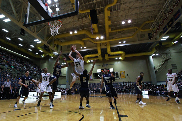 """WEST POINT, N.Y. – Army (11-14, 4-6 PL) overcame a four-point deficit in the first overtime and outscored Navy (3-21, 0-10 PL) 13-7 in the second extra session to claim a 69-63 win in the annual """"Star Game"""" in front of a Christl Arena record crowd of 5,189 Saturday afternoon. The win gave the Black Knights their first season sweep of the Mids since 1992.  Read the full article at http://www.goarmysports.com/sports/m-baskbl/recaps/021112aab.html"""