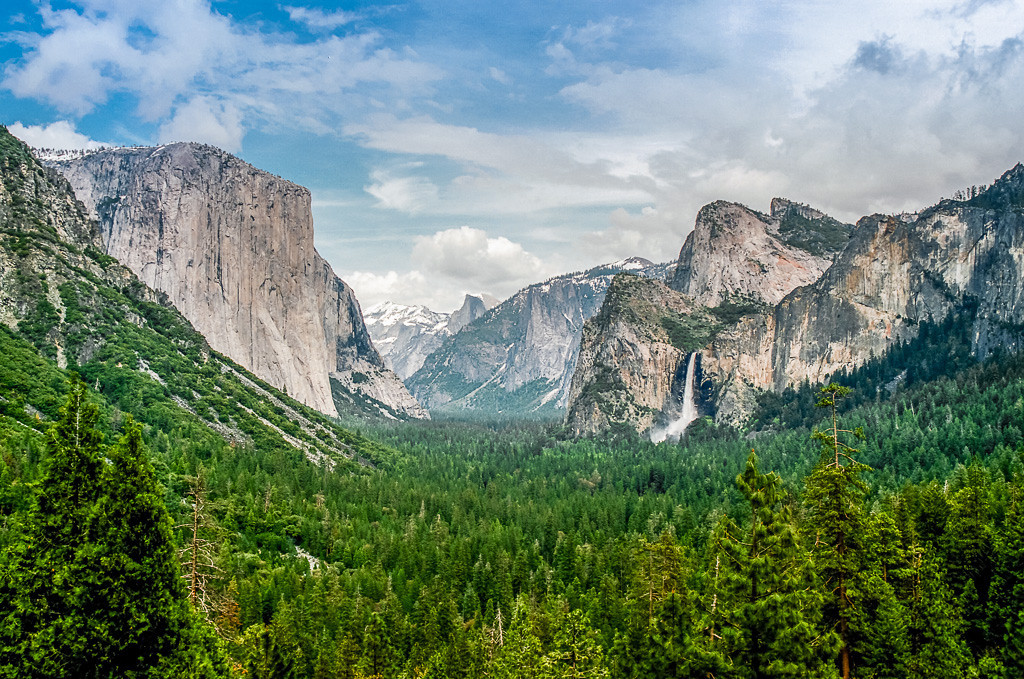 The famous Tunnel View of Yosemite Valley shows Bridal Veil Falls on the right flowing to capacity with the spring runoff.