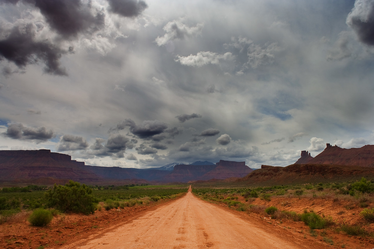 Dirt road and stormy sky, Castle Valley, Utah, near Moab.
