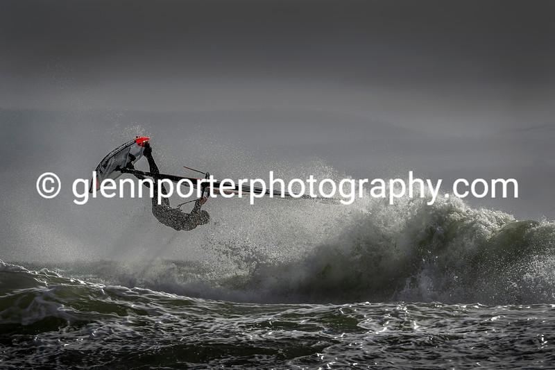 Windsurfer in the spray.