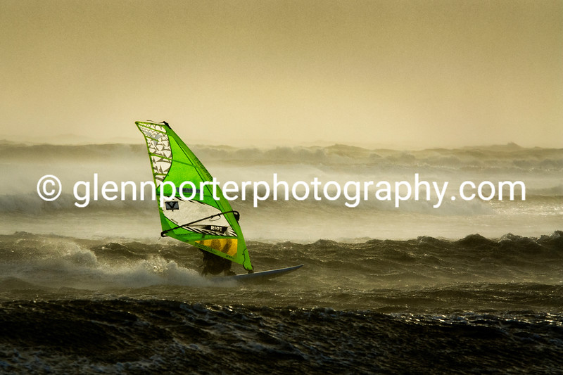 Windsurfing a storm at twilight.