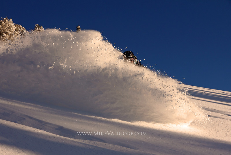 Powder Surfing<br /> Big Cottonwood Canyon, Utah<br /> <br /> High up in the Wasatch backcountry of Big Cottonwood Canyon, Justin McCarty powder surfs the last run of the day in the late afternoon light.