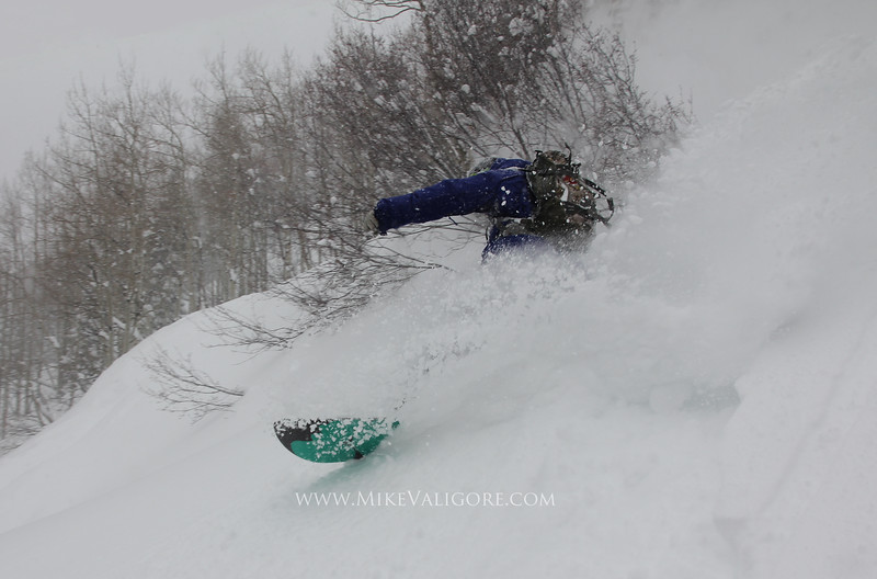 Snowstorm snowboarding<br /> Nick Cowdy slashing in the Vail backcountry