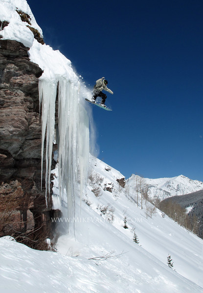Cliff Ice<br /> <br /> Nick Cowdy launches a cliff of ice <br /> Vail backcountry, Colorado
