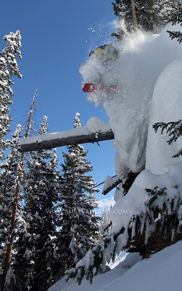 Cliff Powder<br /> <br /> Christopher Brown explodes in a cloud of powder snow off a cliff in the Vail backcountry.