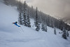 Fresh turns in the half-light of a cloudy winter morning  <br /> Vail backcountry, Colorado