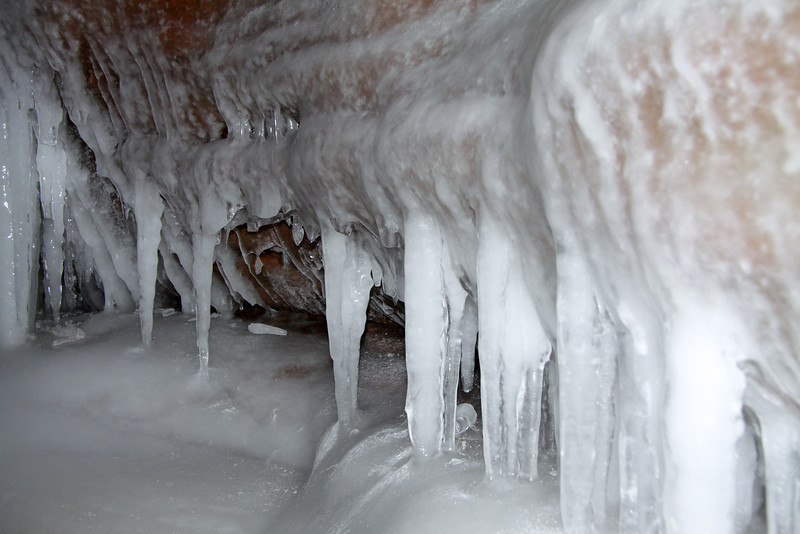 Lake level ice meets the lake wave ice along the sea cave shoreline.