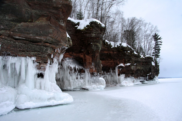 """Lake wave ice upon the sandstone rock shoreline of Bayfield Peninsula - the northern most area of the """"Badger State""""."""