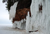 Lake Superior wave ice embellishes the sandstone cliff's stream/waterfall ice - Apostle Islands National Lakeshore.