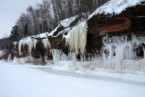 Mammouth icicles or waterfall ice, ice columns, and lake wave ice - along the sandstone cliffs and sea caves - Apostle Islands National Lakeshore.