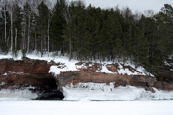 Lake Superior - wave ice, sea cave, sandstone rock cliff, white pines and quaking aspen.
