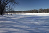 Mid-winter season's fresh snow upon the banks of the St. Croix River - the border between MN and WI, and major tributary to the Mississippi River.