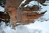 Sedimentary sandstone rock cliffs - meets the ice of Lake Superior.