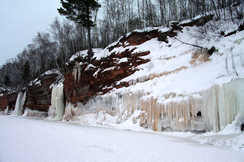 "Ice sculpting along the ""Bowl"" - whose many streams flowing in the fall season, provides the impressive iron oxide waterfalls ice and ice columns/stacks."