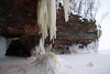Iron oxide icicle, and its ice stalagmite - to the sea cave atop Lake Superior.