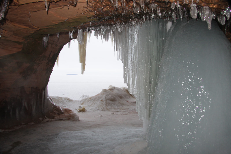 Leached spring water, once flowing/dripping from inside a now, sea/ice cave - out across the frozen Lake Superior, for more than 2 mi (3 km) to Eagle Island, one of the Apostle Islands.