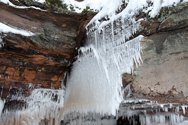 Ice sheet formed from a small stream flowing along the upper cliff ledge.