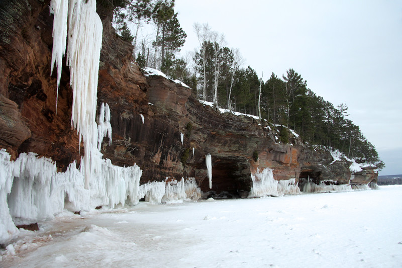 Sandstone sea caves with lake wave and stream/waterfall ice along the Bayfield Peninsula rock cliff - Mawikwe Bay - Lake Superior.