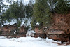 "Lake Superior meets the vegetated sandstone cliffs of the Bayfield Peninsula, at Mawike Bay - which is an Ojibwe term for ""weeping woman"" - the long strands of ice resembling the tears of the indigenous Native American, Ojibwe or Chippewa people - the Red Cliff Band of Lake Superior Chippewa - only surpassed by the Cree people in Canadian population. The Ojibwe call themselves ""Anishinaabeg"" which means the ""True People"" or the ""Original People""."