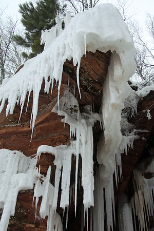 Icicles suspended from the sandstone overhang.
