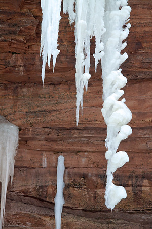 Icicle sculpting along the sandstone cliff.
