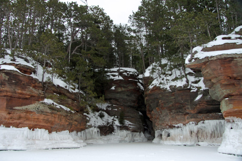 Bayfield Peninsula pines along the sandstone cliffs, with ice waves of Lake Superior below.