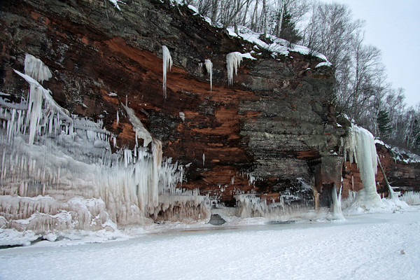 Lake Superior - lichen coated sandstone cliff - wave and waterfall ice - quaking aspen, white pine, and white birch - Apostle Islands National Lakeshore.