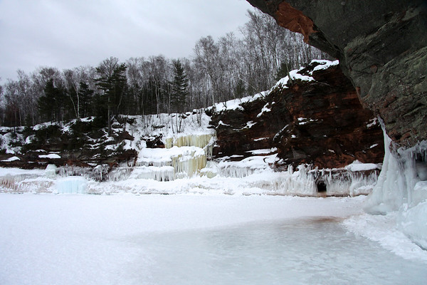 """Lake wave ice, stream/waterfall ice, spring ice, along the sandstone cliffs of the """"Bowl"""" - Bayfield Peninsula, southwest of Sand Point."""