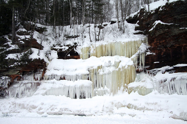 3-tiered stream/waterfall ice, displaying the segmented and suspended iron oxide mineral - with the snow stop.