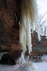 "Iron oxide icicle and ice stalagmite - sedimentary sandstone sea cave - Bayfield Peninsula - the ""Bowl"" area."
