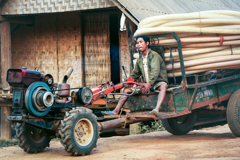 Vietnamese Man Operating Tractor