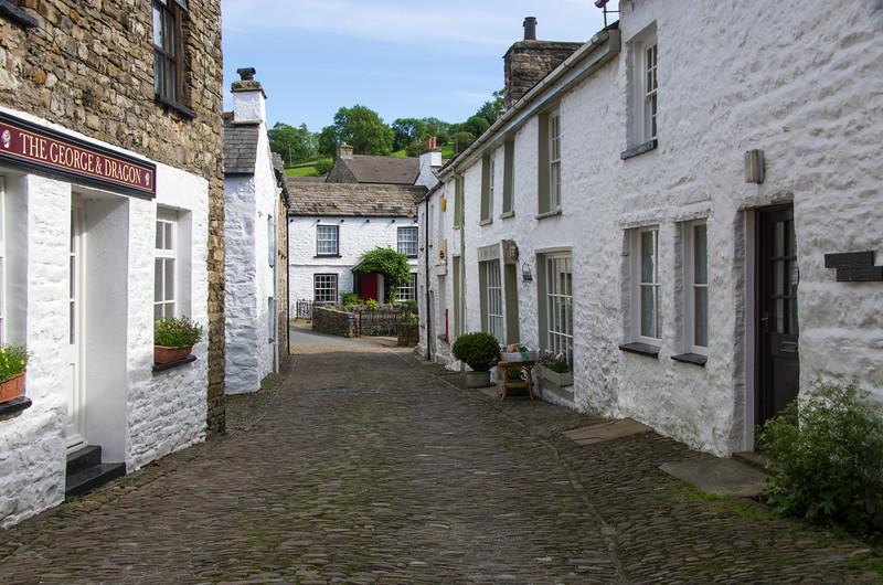 Dent cobbled street
