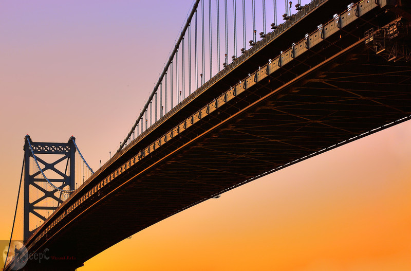 """A Warm Evening""<br /> <br /> This is the image of Ben Franklin bridge Philadelphia USA. I waited long for these warm colors which appeared only for few minutes. It was almost dark, and camera could still capture those shadow details well. The light you see on the bridge, is coming from the horizon after the sun went down."