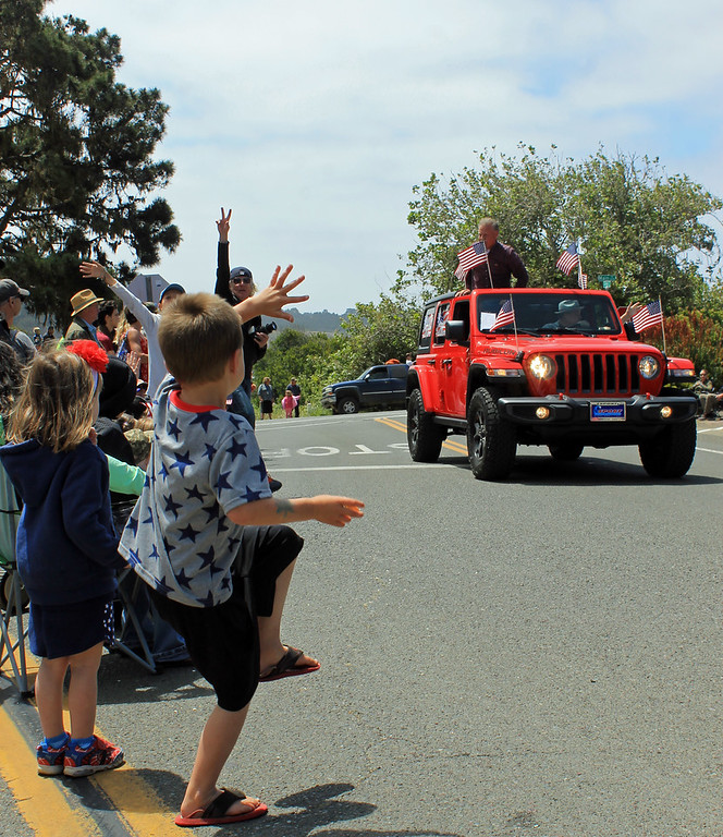 . Mendocino County Sheriff Tom Allman gets an enthusiastic greeting as the parade begins.