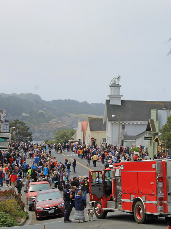 . Town fills up as parade time approaches.